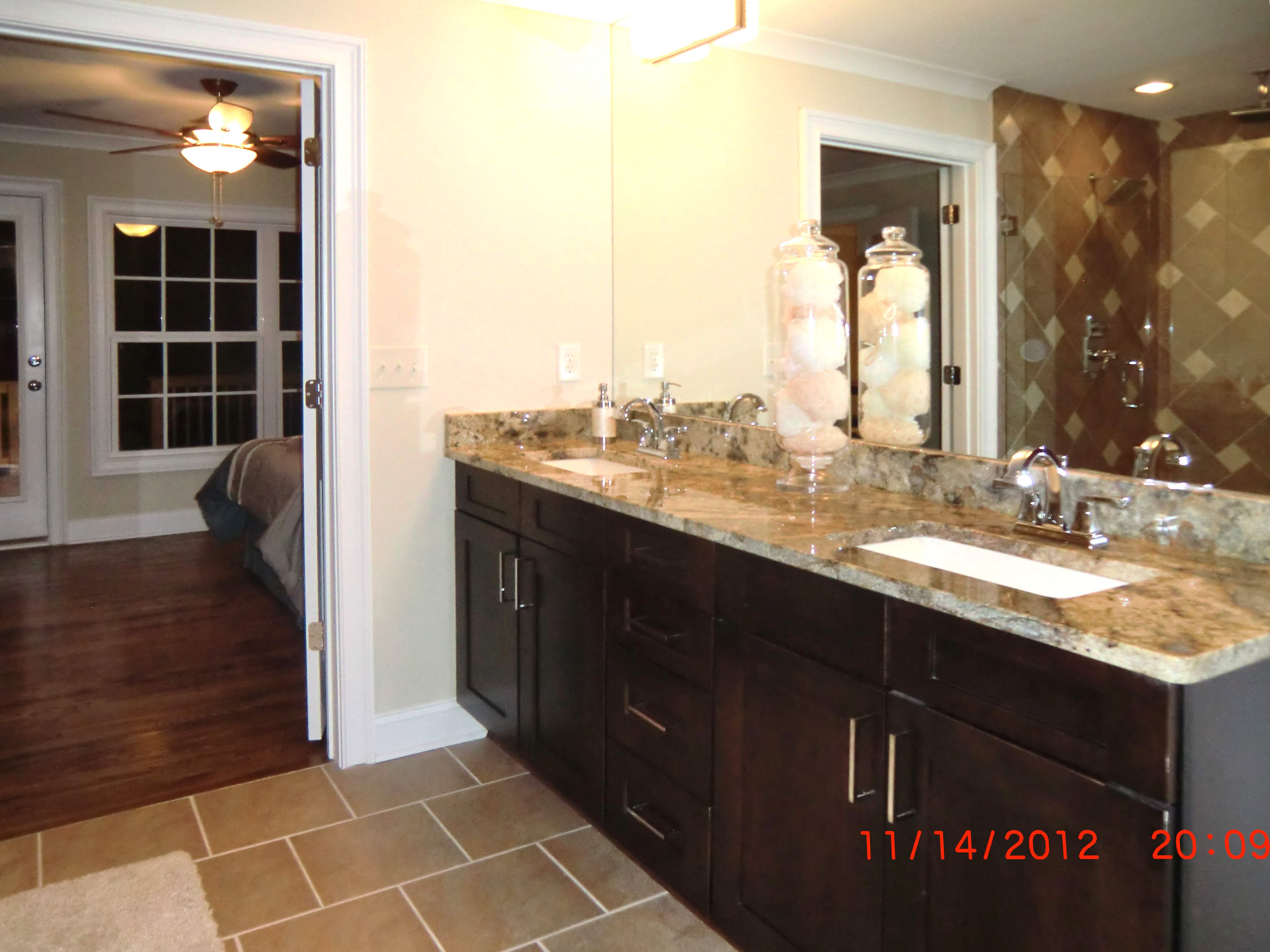 All new tiled master bath with granite countertops