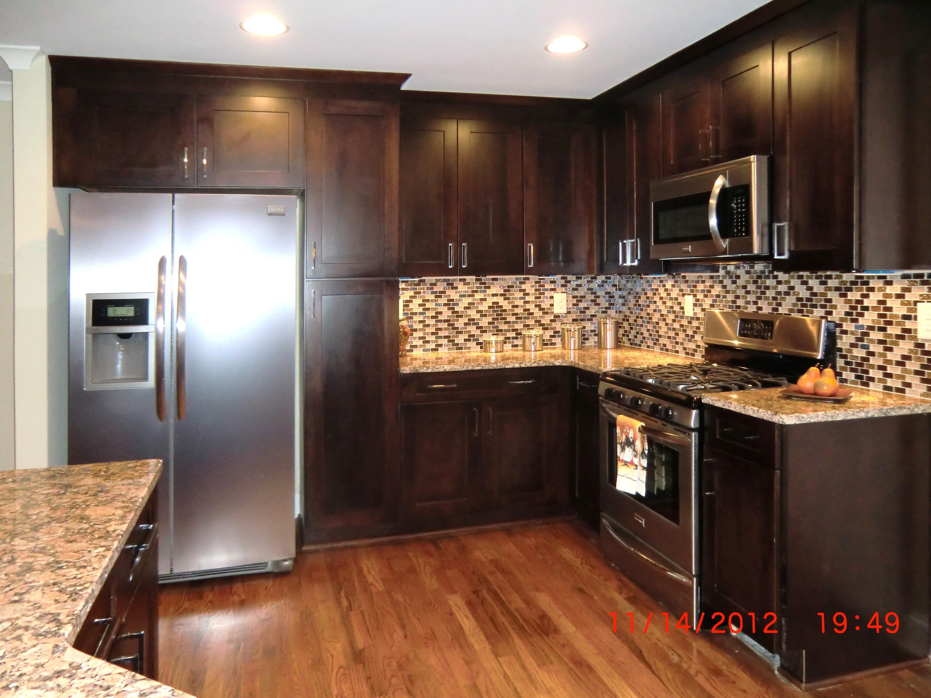 All New Kitchen With Rich Dark Cabinets